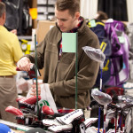 Golfers eager to get out on the course shop for new clubs at the Northern Indiana Golf Show.